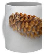 Spruce Tree Cone In The Snow Coffee Mug