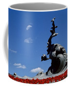 Statue And Tulips Against A Clear Blue Coffee Mug