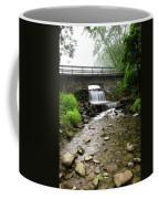 Stone Bridge Over Small Waterfall Coffee Mug