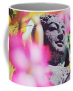 Stone Carved Statue Of Buddha Surrounded With Colorful Flowers Bali, Indonesia Coffee Mug