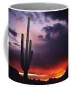 Storm Clouds Pass Over A Saguaro Catus Coffee Mug
