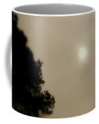 Sun Battles Fog Coffee Mug