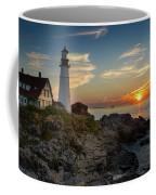 Sun Rising At Portland Head Light Coffee Mug