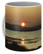 Sunset Over Mountains And Water Coffee Mug