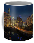 The Glimmering Neon Lights Of The Downtown Austin Skyscrapers Illuminate The Skyline Over Lady Bird Lake Coffee Mug