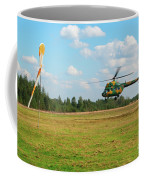 The Helicopter Over A Green Airfield. Coffee Mug