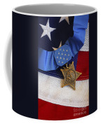 The Medal Of Honor Rests On A Flag Coffee Mug