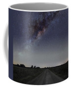 The Milky Way Galaxy Over A Rural Road Coffee Mug by Luis Argerich