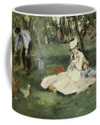 The Monet Family In Their Garden At Argenteuil Coffee Mug
