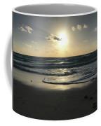 The Sun Is Rising Over The Ocean Coffee Mug