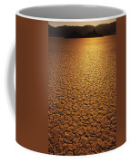 The Sun Reflects Off This Parched Lake Coffee Mug by Bill Hatcher
