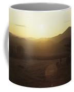 The Sun Sets Over The Mountains Coffee Mug