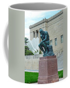 The Thinker And The Shuttlecock Coffee Mug