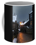 The Village Of Heptonstall In The Snow At Night With Lamps Shini Coffee Mug