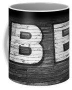 The Word Be Painted On The Side Of Old Building Coffee Mug