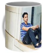 Young Boy Thinking Outside Coffee Mug