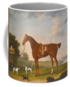 Thomas Egerton's Chestnut Hunter With A Groom And Two Hounds And A Terrier In A River Landscape Coffee Mug