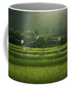 Three Boys Are Happy To Play Kites At Summer Field In Nature In  Coffee Mug