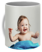 Toddler With A Cozy Blanket Sitting And Smiling. Coffee Mug