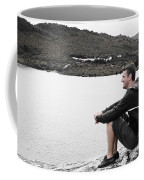 Tourist Seated At Dove Lake Lookout In Tasmania Coffee Mug