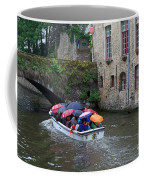Tourists With Umbrellas In A Sightseeing Boat On The Canal In Bruges Coffee Mug