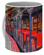 Train In Amusement Park Coffee Mug by Gunter Nezhoda