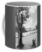Tree And People By The Lake Coffee Mug