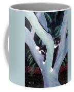 Tuxedo Cat In Mimosa Tree Coffee Mug by Karen Zuk Rosenblatt