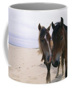 Two Curious Wild Horses On The Beach Coffee Mug by Nick Caloyianis