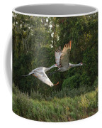 Two Florida Sandhill Cranes In Flight Coffee Mug