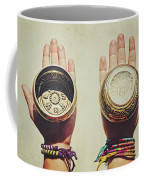 Two Hands Holding And Showing Both Sides Of Decorated Tibetan Singing Bowls Coffee Mug