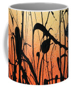 Two Orbs Meet In A Field At Sunset Coffee Mug