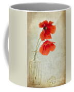 Two Poppies In A Glass Vase Coffee Mug