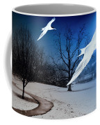 Two Seagulls Fly Together In The Clear Blue Sky Coffee Mug by Fernando Cruz
