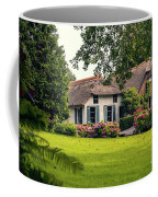 typical dutch county side of houses and gardens, Giethoorn Coffee Mug