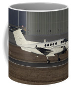 U.s. Army C-12 Huron Liaison Aircraft Coffee Mug by Timm Ziegenthaler