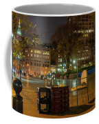 View Of Chess Board In The Middle Of Busy Sidewalk At Night Coffee Mug