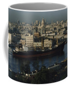 View Of City And A Massive Freighter Coffee Mug by James L. Stanfield
