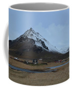 Village Of Arnastapi At The Base Of Mount Stapafell Coffee Mug