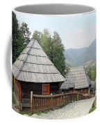 Village With Wooden Cabin Log On Mountain Coffee Mug