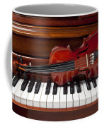 Violin On Piano Coffee Mug by Garry Gay
