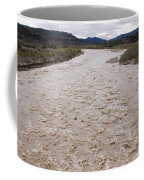 Water Flowing After Record-setting Coffee Mug by Rich Reid