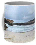 Waves Crashing Ashore With Large Rock Formations Coffee Mug