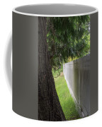 White Fence And Tree Coffee Mug by Tom Singleton