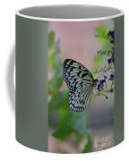 White Tree Nymph Polinating Purple Flowers Coffee Mug