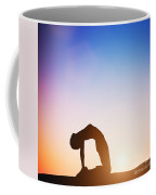 Woman In Camel Yoga Pose Meditating At Sunset Coffee Mug