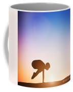 Woman In Crane Pose Yoga Pose Meditating At Sunset Coffee Mug