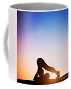 Woman In Plow Yoga Pose Meditating At Sunset Coffee Mug