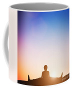 Woman In Wide Angle Bend Yoga Pose Meditating At Sunset Coffee Mug
