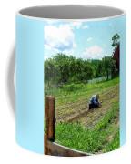 Woman Planting Garden Near Barn Coffee Mug